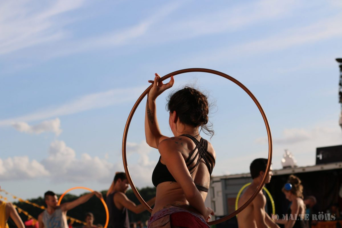 Woman playing hula hoop during the European Juggling Convention (EJC) 2016 in Almere, Netherlands