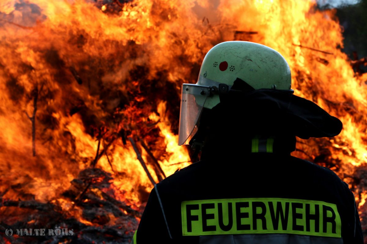 Firefighter in front of an impressive Easter fire